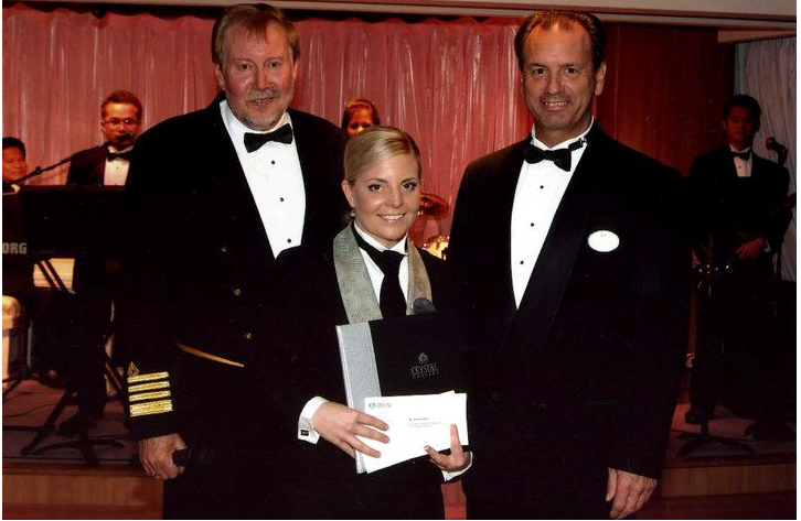 """Sumey being awarded """"Employee of the Month"""" on board Crystal Cruises in 2011"""